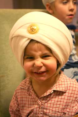 Charanjeet trying on Arjan's turban after she took it off.